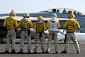US Navy 070715-N-8119R-060 Capt. Michael C. Manazir, commanding officer of USS Nimitz (CVN 68), stands alongside flight deck personnel as an F-A-18F Super Hornet, assigned to the Black Aces of Strike Fighter Squadron (VFA) 41,.jpg