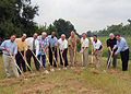 US Navy 070810-N-7427G-001 Capt. Walter J. Adelmann along with members of the Plaquemines Parish City Council break ground on a new drainage system located near Naval Air Station, Joint Reserve Base, New Orleans.jpg