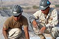 US Navy 080112-N-0260R-006 Builder 2nd Class Johan Sanchez and Steel Worker 3rd Class Andrew Heffron, both assigned to Naval Mobile Construction Battalion (NMCB) 40, work at a building construction site in Obock.jpg