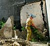 US Navy 080714-N-9689V-007 Sapper Kris Eyles, assigned to the Australian Army 3rd Combat Engineer Regiment, knocks down a wall during a Pacific Partnership engineering civic action program.jpg