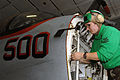 US Navy 080729-N-5248R-002 Aviation Electrician's Mate 2nd Class Ann Music, works on an EA-6B Prowler.jpg