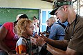 US Navy 080817-N-7955L-021 Lt. Cmdr. Louis Cimorelli, assigned to the amphibious assault ship USS Kearsarge (LHD 3), examines a child at the Betania medical clinic.jpg