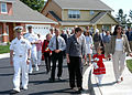 US Navy 090615-N-8770A-002 Capt. Gerral David, commanding officer of Naval Air Station Whidbey Island, leads guests on a tour of new homes.jpg
