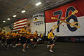 US Navy 090913-N-3659B-294 Chief Storekeeper (sel.) Adriana Cabarcas leads her fellow chief petty officer selects in physical training in the hangar bay of the Nimitz class aircraft carrier USS Ronald Reagan (CVN 76).jpg