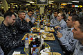 US Navy 100106-N-8273J-268 Master Chief Petty Officer of the Navy (MCPON) Rick West, middle left, dines on the mess decks with Sailors aboard the aircraft carrier USS Nimitz (CVN 68).jpg