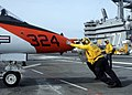 US Navy 100424-N-6509M-199 Sailors assigned to the aircraft carrier USS George H.W. Bush (CVN 77) push a T-45C Goshawk training aircraft assigned to Carrier Training Wing (CTW) 2 on the ship's flight deck.jpg