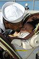 US Navy 100817-N-5292M-942 Naval Career Counselor 1st Class Osman Kamara kisses his six-week-old son goodbye before boarding USS Laboon (DDG 58).jpg
