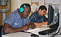 US Navy 100907-N-7682A-001 Leading Seaman Ronnie Neymour, left, from the Royal Bahamas Defense Force,.jpg