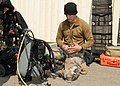 US Navy 110325-N-MU720-016 Explosive Ordnance Disposal 1st Class Dillon Mudloff checks diving equipment before a salvage operation.jpg