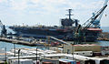 US Navy 110521-N-WX729-038 The aircraft carrier USS Theodore Roosevelt (CVN 71), assisted by tugboats, transits the James River to relocate from dr.jpg