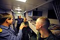 US Navy 110525-N-YZ751-076 Capt. Richard Powell, right, commanding officer of the Royal Navy destroyer HMS Dauntless (D33), gives a tour of one of.jpg