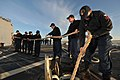 US Navy 111126-N-YZ751-025 Sailors aboard the guided-missile destroyer USS Truxtun (DDG 103) stow a handling line after departing Civitavecchia, It.jpg