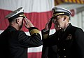 US Navy 111202-N-DR144-497 Capt. Kent D. Whalen, right, relieves Capt. Bruce H. Lindsey as the commanding officer of the Nimitz-class aircraft carr.jpg