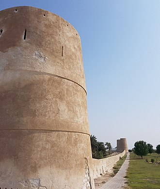 Umm Al Quwain - The protective wall and watchtowers guarding the old town of Umm Al Quwain