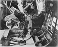United States Army Air Force gunner Sgt. William Watts of Alexandria, La. fires machine gun on enemy during aerial... - NARA - 196309.tif