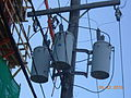 Utility pole triple with containers.JPG