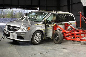 Crash test - 2018 Dodge Grand Caravan being struck by a mobile deformable  barrier at 62 km/h.