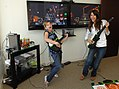 Victoria Justice and Aria Wallace playing guitar hero.jpg