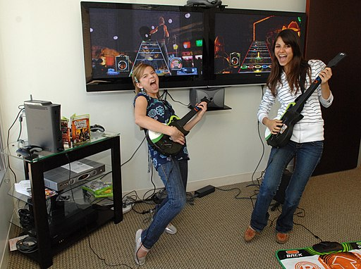 Victoria Justice and Aria Wallace playing guitar hero