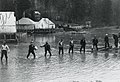 View of workers battling flood waters at Decoigne Camp (16551109533).jpg