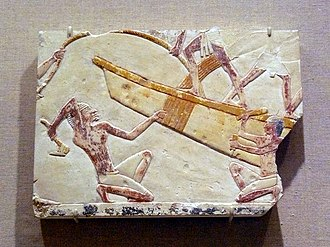Adze - Egyptian boat-building relief, featuring a workman using an adze