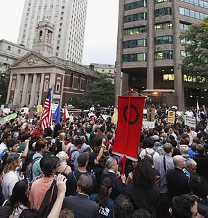Occupy movement - Protesters rallying near New York police headquarters, with St. Andrew's Church in the background