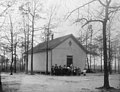 "Watery Branch School, Wayne County, NC; ca 1905. Students and their teacher pose in a group outside a rural frame one-room school house. A handwritten ID label (incorrectly spelled ""Water Branch"") is (19090633835).jpg"