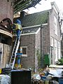 Werkzaamheden aan ronde stenen stellingmolen - AMR Molenfoto - 20538354 - RCE.jpg