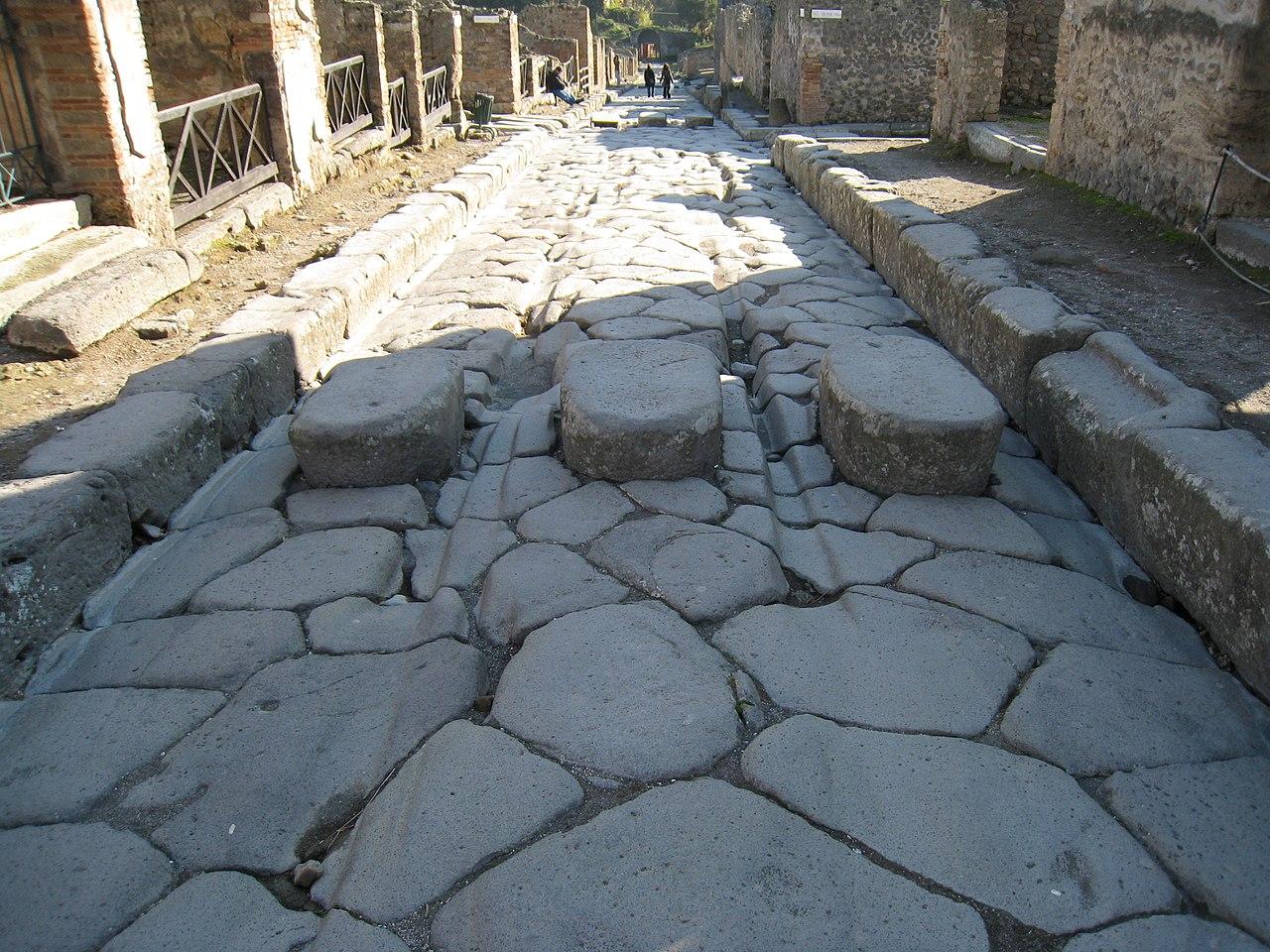 1280px-Wheel_ruts_Pompeii.JPG