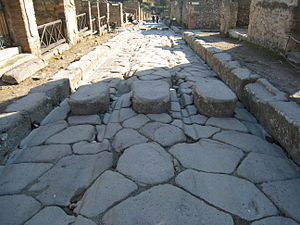 Wheel ruts on a street corner in the ruins at ...