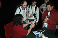 Wikimania 2009 - Stallman talking about rebelion.org with wikipedians.jpg