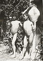 Wilhem von Gloeden (1856-1931) - Two nude youths posing in his garden.jpg