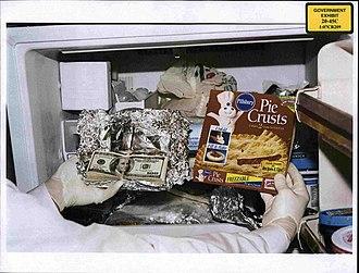 Bribery - Photo of cash found in Congressman William J. Jefferson's freezer in the August 2005 raid was shown to jurors on 8 July 2009