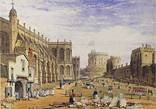A painting showing a stone chapel on the left, with a timber built entrance, out of which are parading a number of white clad individuals. In the middle of the painting is a grassy area, across which are marching various red-uniformed soldiers, on the right hand side is a line of stone buildings, with a circular tower on a mound in the far distance.