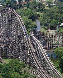 The cars of a roller coaster reach their maxim...