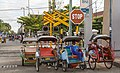 Yogyakarta Indonesia Rickshaws-waiting-at-level-crossing-for customers-01.jpg