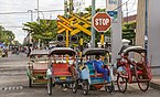 Yogyakarta Indonesia Rickshaws-waiting-at-level-crossing-for customers-01.jpg