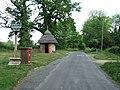 -2011-05-19 Brickwork pier mounted post box and the village sign, Merton, Norfolk.jpg