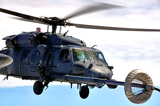 129th Rescue Squadron - An HH-60G Pave Hawk helicopter from the 129th Rescue Squadron performs an aerial refueling with a MC-130P Combat Shadow from the 130th Rescue Squadron,