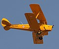 1930's Vintage Tiger Moth aircraft showing its aerobatic skills at the Aero India 2013, at Yelahanka, Bangalore on February 06, 2013.jpg