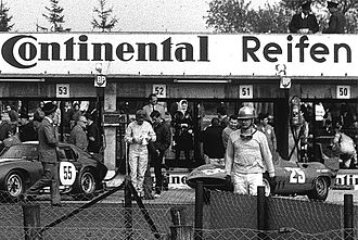 Hans Herrmann - Hans Herrmann before the start of the 1965 1000km Nürburgring, behind him the Fiat Abarth