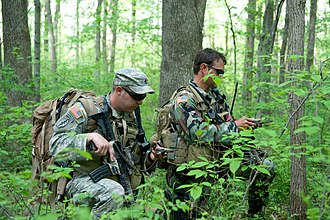 Special Forces (United States Army) - Two Army National Guardsmen from the 2nd Battalion, 19th Special Forces Group check their course with compasses during a training exercise in 2011