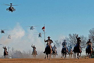 The 1st Cavalry Division's combat aviation brigade performing a mock charge with the horse detachment 1 CAV DIV charge.jpg