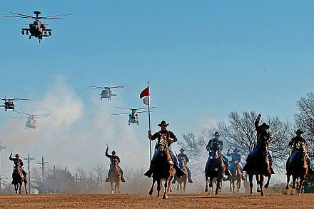 The 1st Cavalry Division's combat aviation brigade performs a mock charge with the horse detachment 1 CAV DIV charge.jpg