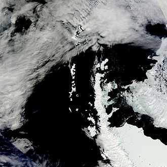 Antarctic Peninsula - Nearly cloud-free view of the northern tip of the Antarctic Peninsula during Spring.