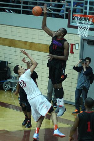 Block (basketball) - Cliff Alexander blocks a shot during the 2013 IHSA playoffs