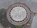 2017-10-12 (206) Manhole cover at Bahnhof Neubruck.jpg