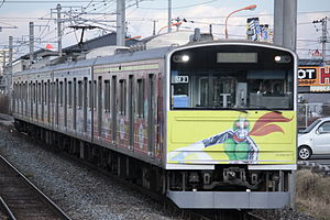 Kamen Rider Series - A 205 series train on the Senseki Line with Kamen Rider and other Shotaro Ishinomori character livery. The Senseki Line has a terminal in Ishinomori's hometown of Ishinomaki, Miyagi Prefecture.