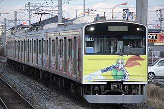 Kamen Rider - A 205 series train on the Senseki Line with Kamen Rider and other Shotaro Ishinomori character livery. The Senseki Line has a terminal in Ishinomori's hometown of Ishinomaki, Miyagi Prefecture.