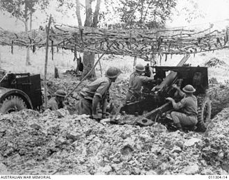 Battle of Muar - Australian 25 pounder gun crew preparing to open fire on approaching Japanese at Bakri.